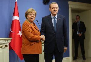 German Chancellor Merkel and Turkey's Prime Minister Erdogan shake hands following a joint news conference in Ankara